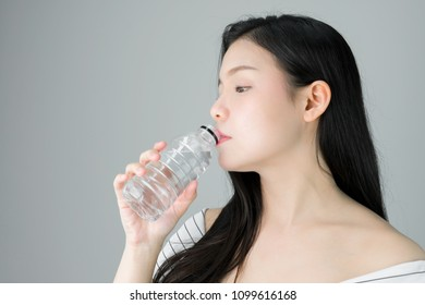 woman skin beauty and health, Drinking water from a clean bottle. The skin is smooth and beautiful. concept of healthy women, on white background.