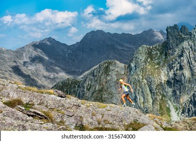 Woman skyrunner trains in the mountains
