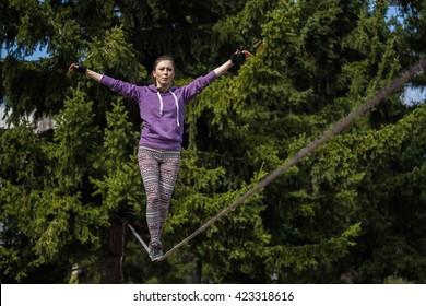 Woman slacklining