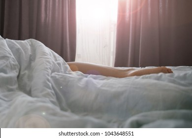 woman sleep in bed sunshine thought the window