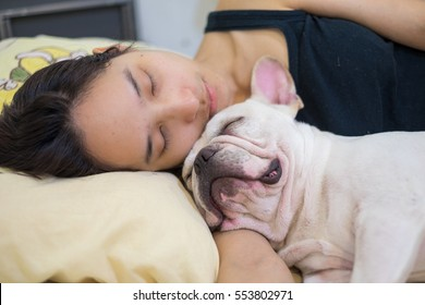 Woman sleep with dog , Nap with hugging dog