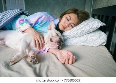 Woman sleep with dog , Nap with hugging dog in the loft bedroom at night, Warm hug to your pets. Stay with indoor dog. Close relationship between Dogs and dog owners. Watch over the house at night