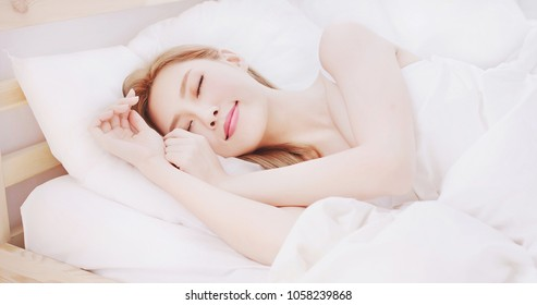 woman sleep on the bed at home in morning