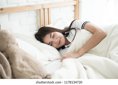 Woman sleeping in bedroom at the morning