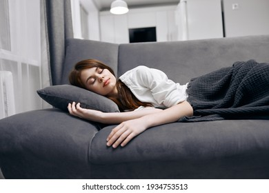 woman sleeping at home on the couch rest