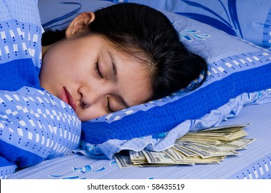woman sleeping with money under her pillow