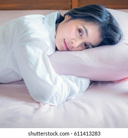 woman sleeping on the bed at the morning.
