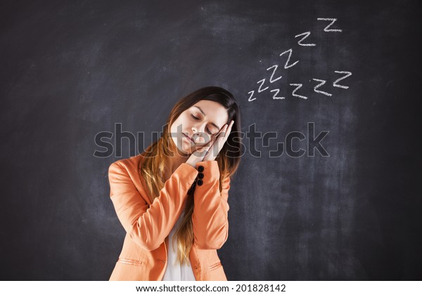 Woman sleeping with sound on the chalkboard