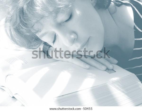 Woman sleeping while doing her study