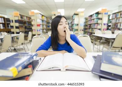 Woman sleepy in library