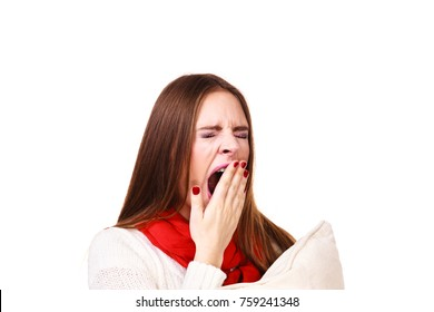 Woman sleepy tired girl yawning holding pillow almost falling asleep. Health balance sleep deprivation concept. Female student or worker with lack of slumber on white