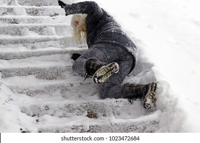 A woman slipped and fell on a wintry staircase. Fall on smooth steps