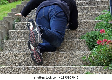A woman slipped on a staircase and fell down. A woman falling down a staircase