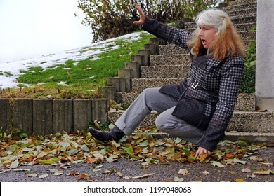 A woman slipped on wet leaves and fell. Wet leaves are dangerous