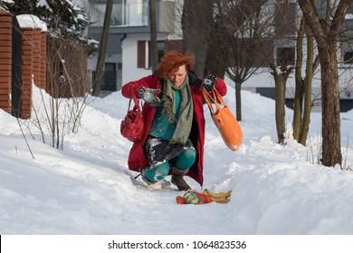 woman slipping on sidewalk, winter accident
