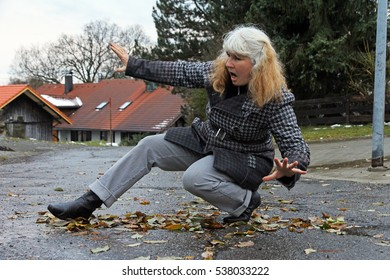 A woman slips out. Wet and smooth roads can lead to accidents