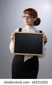 Woman with small blackboard