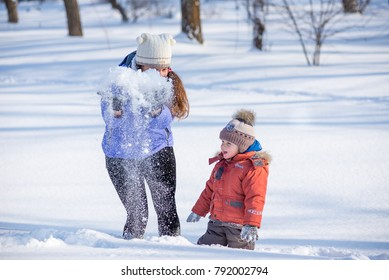 woman with a small child in the park for a winter walk.
