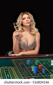 woman in a smart dress plays roulette.