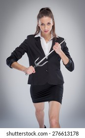 Woman in smart suit and holding a training sword.