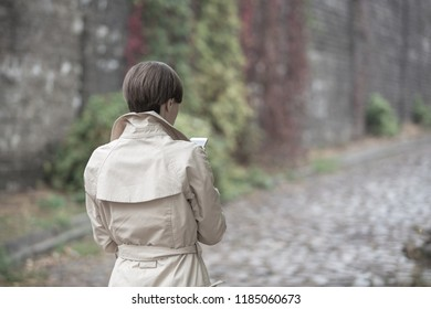 Woman with smartphone walking in the street