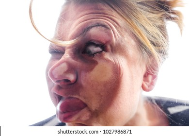 woman smashed accidently against a window, and makes a funny grimace