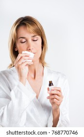 woman smelling a handkerchief soaked in essential oil