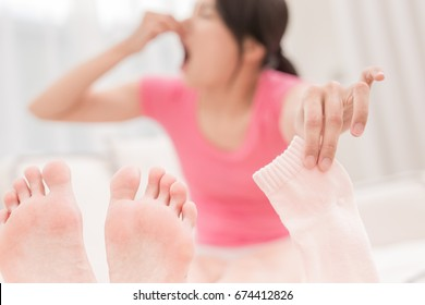 woman with smelly socks in the room