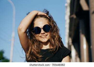 Woman with a smile in glasses