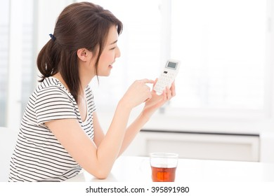 Woman of the smile having an electronic calculator