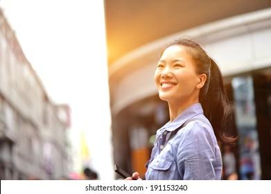 woman smile on shopping street
