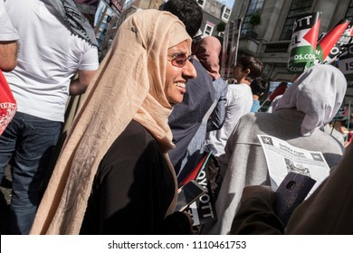 A woman smiles during the Al Quds Day rally, London, 10/06/18.