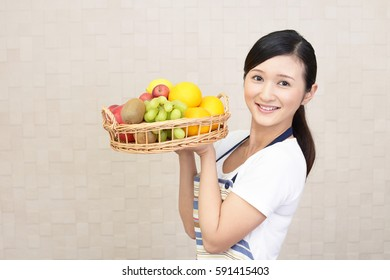 Woman smiling with fruits