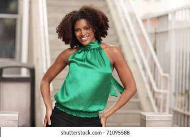 Woman smiling with hands on hips