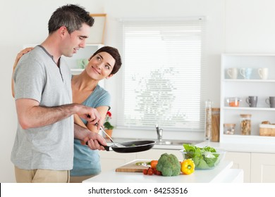 Woman smiling at her husband in a kitchen