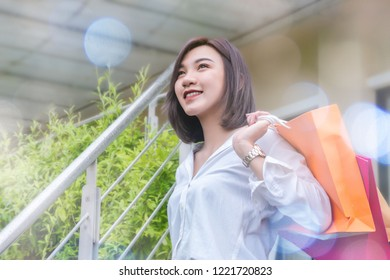 woman smiling and hold shopping bug , she happy time on the day mid year sale