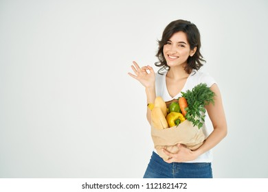 woman smiling holding a package with food