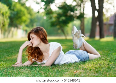 woman smiling woman lies on lawn, summer, spring,