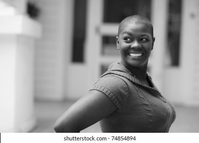 Woman smiling and looking over her shoulder