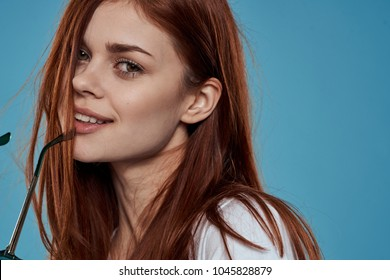woman smiling on blue background, portrait