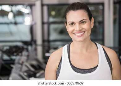 Woman smiling in sportswear in the gym