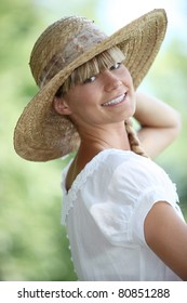 Woman smiling with straw hat