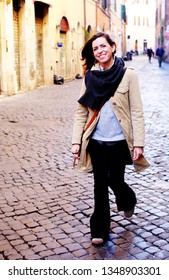 Woman smiling and walking at the city