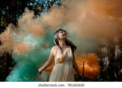 woman with a smoke bomb in the forest