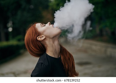 Woman with smoke in the park