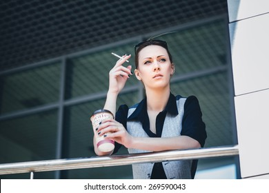 woman smokes on a break, Businesswoman smoking a cigarette in the office