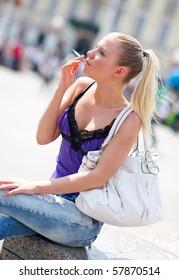 Big boobs brunette smoking a cigarette #2