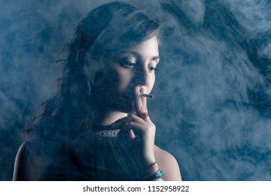 Woman Smoking a Cigarette Surrounded with Smoke