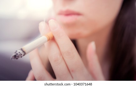 Woman smoking cigarette, unhealthy lifestyle concept, close up