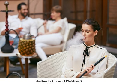 Woman Smoking Shisha In Hookah Bar